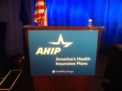AHIP podium signage